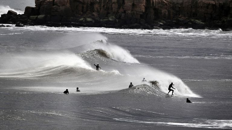 Surfers in the North sea at Tynemouth, despite advice telling them to stay at home